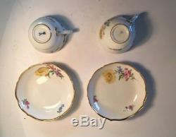 A Set Of Two Meissen Demitasse Cup and Saucer with Yellow Flowers